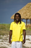 Man with yellow t-shirt in cuba. Black man with yellow t-shirt walking on the beach Stock Photography
