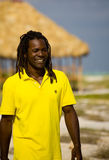 Man with yellow t-shirt in cuba. Black man with yellow t-shirt walking on the beach Stock Images