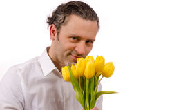 Man with yellow tulips Stock Photography
