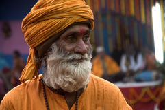 A man with a yellow turban. Portrait of a monk with yellow turban  at a local religious festival in India Royalty Free Stock Photo