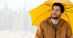 Man with yellow umbrella in bright forest Royalty Free Stock Photos