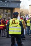 Man with yellow vest and bicycle protesting against the pension reform from the government