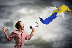 Man yells into a megaphone Royalty Free Stock Image