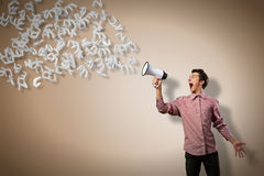 Man yells into a megaphone Stock Images