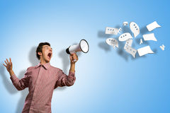 Man yells into a megaphone Royalty Free Stock Photo