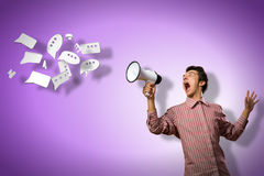 Man yells into a megaphone Stock Photo