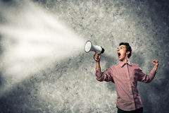 Man yells into a megaphone Royalty Free Stock Images