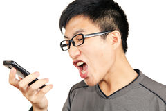Man yells to his phone Stock Image