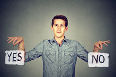Man with yes no signs. Man holding yes no signs choices stock image
