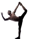 Man yoga asanas natarajasana dancer pose Royalty Free Stock Photo