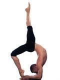 Man yoga  Eka Pada Viparita Dandasana pose. Caucasian man Eka Pada Viparita Dandasana One-legged Inverted Staff  pose stretch acrobatics yoga balance posture Stock Photography