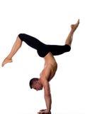 Man yoga handstand full length gymnastic. One caucasian man yoga handstand gymnastic acrobatics full length studio isolated on white background stock image