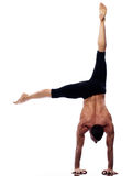 Man yoga handstand full length gymnastic. One caucasian man yoga handstand gymnastic acrobatics full length studio isolated on white background Royalty Free Stock Photos