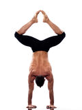 Man yoga handstand full length gymnastic. One caucasian man yoga handstand gymnastic acrobatics full length studio isolated on white background Stock Photo