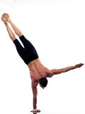 Man yoga handstand full length gymnastic. One caucasian man yoga handstand gymnastic acrobatics full length studio isolated on white background Stock Images