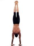 Man yoga handstand full length gymnastic acrobatic. One caucasian man yoga handstand gymnastic acrobatics full length studio isolated on white background Stock Images