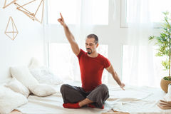 Man in a yoga pose does gymnastics. Stock Photography