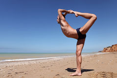 Man in yoga pose the king of dances Royalty Free Stock Photo