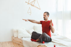 Man in a yoga pose in nirvana. Royalty Free Stock Image