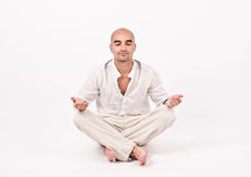 Man in yoga position. Royalty Free Stock Image