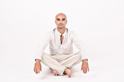 Man in yoga position. Royalty Free Stock Photography