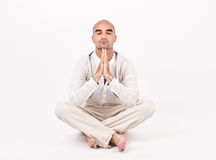Man in yoga position. Stock Photos