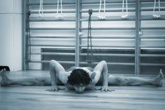 Man yoga teacher splits Stock Image