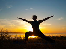 Man in yoga warrior pose. Standing  outdoors Stock Image