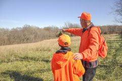 Man teaching boy to hunt Royalty Free Stock Images