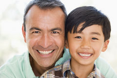 Man and young boy smiling Stock Images