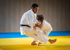 Man and young boy are training judo throw. Ing royalty free stock photos