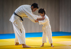 Man and young boy are training judo throw. Ing stock photos