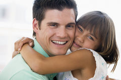 Man and young girl hugging and smiling Royalty Free Stock Photography