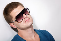 Man young handsome athlete with sunglasses and t-shirt Royalty Free Stock Images