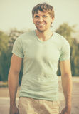 Man young handsome happy smiling face Stock Photos