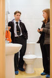 Man with young realtor look small and clean toilet Royalty Free Stock Image