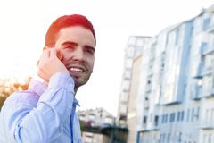 Man young speaking by phone Royalty Free Stock Images