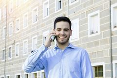 Man young speaking by phone Royalty Free Stock Image