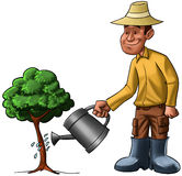 Man and young tree. Farmer sprinkling a young tree, he is very happy Royalty Free Stock Photos