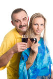 The man and the young woman the blonde. On a white background with glasses of wine Stock Photo