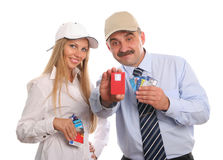 The man and the young woman with credit cards royalty free stock image