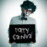 Man with a zombie costume with a signboard with the text happy c Stock Image
