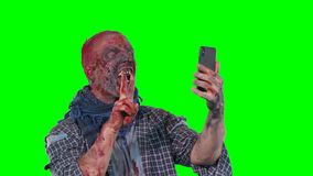 Man in zombie makeup makes selfie phone