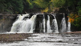 Manabezho Falls Loop. Manabezho Falls, a beautiful waterfall on the Presque Isle River, tumbles over a rocky cliff not in Michigan's western Upper Peninsula stock video