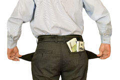 Manaffärsman som visar tomma fack som döljer bak buntar av pengar Arkivfoto