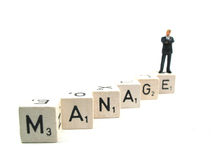 Manage. A manager standing on the word manage stock photo