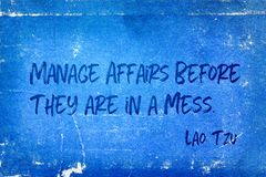 Manage affairs Tzu. Manage affairs before they are in a mess - ancient Chinese philosopher Lao Tzu quote printed on grunge vintage cardboard royalty free stock image