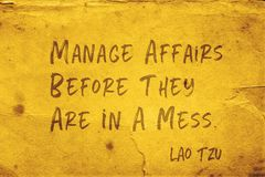 Manage affairs Lao Tzu. Manage affairs before they are in a mess - ancient Chinese philosopher Lao Tzu quote printed on grunge yellow paper stock photo