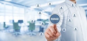 Manage management. Manager click on button with text manage. Managerial business concept. Wide banner composition with office in background Royalty Free Stock Photography