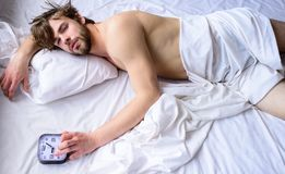 Manage proper regime tips. Toughest part of morning simply getting out of bed. Guy sleep missed alarm clock ringing. Oversleep problem. Man unshaven sleepy royalty free stock image